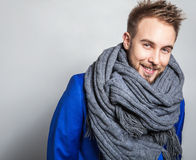 Elegant & Positive young handsome man in scarf. Studio fashion portrait. Royalty Free Stock Photos