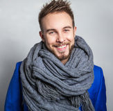 Elegant & Positive young handsome man in scarf. Studio fashion portrait. Stock Photography
