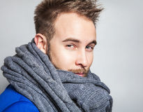 Elegant & Positive young handsome man in scarf. Studio fashion portrait. Royalty Free Stock Photography