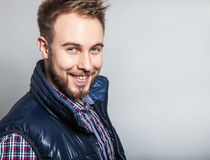 Elegant & positive young handsome man. Studio fashion portrait. Royalty Free Stock Image
