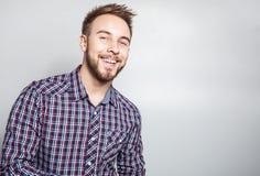 Elegant & positive young handsome man. Studio fashion portrait. Stock Photography
