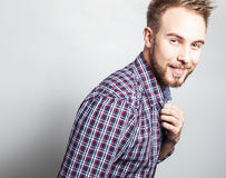 Elegant & positive young handsome man. Studio fashion portrait. Royalty Free Stock Photo