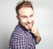 Elegant & positive young handsome man. Studio fashion portrait. Stock Photo