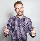 Elegant & positive young handsome man. Studio fashion portrait. Stock Image
