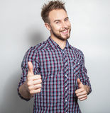 Elegant & positive young handsome man. Studio fashion portrait. Royalty Free Stock Images