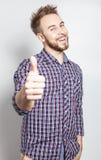 Elegant & positive young handsome man. Studio fashion portrait. Royalty Free Stock Image