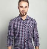 Elegant & positive young handsome man. Studio fashion portrait. Stock Photos