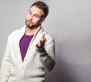 Elegant & positive young handsome man. Studio fashion portrait. Stock Photography