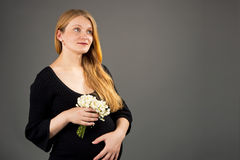 Elegant pregnant blonde with flowers Stock Photo