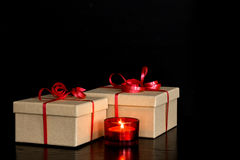 Elegant presents and red candlelight Royalty Free Stock Image