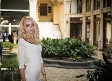 Elegant pretty blonde young woman in posh city setting in Europe Royalty Free Stock Images