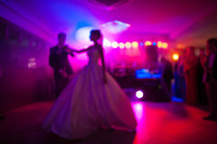 Elegant pretty young bride and groom  dance. Elegant pretty young bride and groom first dance Royalty Free Stock Photography