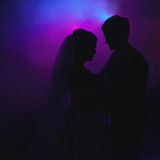 Elegant pretty young bride and groom dance Stock Photo
