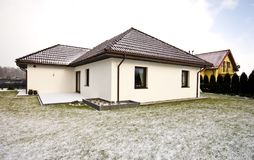 Modern private house in winter, abstract architecture real estate Royalty Free Stock Photo