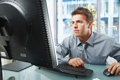 Professional working on computer Royalty Free Stock Photos