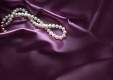 Elegant purple background with silk and pearls Stock Photo