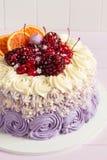 Elegant purple rosette cake decorated with fruit Royalty Free Stock Photos