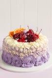 Elegant purple rosette cake decorated with fruit Royalty Free Stock Image