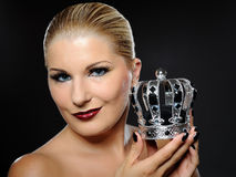 Elegant queen female face with red shiny lips Stock Images