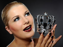 Elegant queen female face with red shiny lips Royalty Free Stock Image