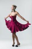 elegant röd kvinna för härlig klänning arkivfoton