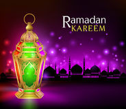 Elegant Ramadan Kareem Lantern or Fanous. Beautiful Elegant Ramadan Kareem Lantern or Fanous in Gold With Colorful Lights in Silhouette Mosque Background for the Stock Image