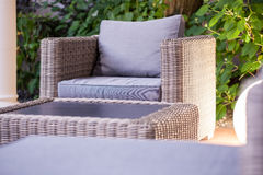 Elegant rattan garden furniture. Close up of elegant rattan garden furniture Royalty Free Stock Photo