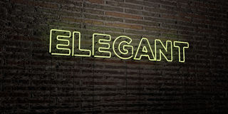 ELEGANT -Realistic Neon Sign on Brick Wall background - 3D rendered royalty free stock image Stock Image