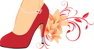 Elegant red female shoes with lilies Royalty Free Stock Photos