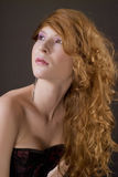 Elegant red hair woman portrait. Elegant and tender red hair woman portrait over dark background Royalty Free Stock Photography