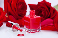 Elegant red nail varnish in a stylish bottle Royalty Free Stock Photo