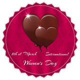 Elegant red silk background with ornament, melting chocolate heart. With the inscription International Women`s Day on March 8th. Suitable for invitations Royalty Free Stock Photo
