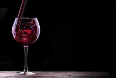 Elegant red wine glass in black background Royalty Free Stock Images