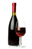 Elegant red wine glass and a wine bottle Stock Image