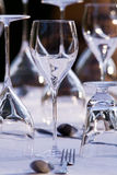 Elegant restaurant table setting. Beautifull restaurant setting of glasses and cutlery on a table Stock Photography