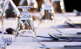Elegant restaurant table setting. Beautifull restaurant setting of glasses and cutlery on a table Royalty Free Stock Photo