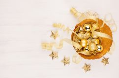 Elegant rich gold christmas home decoration on white wood background, top view. Royalty Free Stock Photos