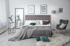 Elegant room interior with large comfortable bed royalty free stock images