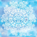 Elegant round lacy doily on watercolor background. Stock Image
