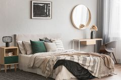 Free Elegant Round Mirror In Wooden Frame Above Fancy Console Table With Flowers In Vase In Trendy Bedroom Interior With Beige Vase Stock Photo - 152857650