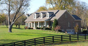 Elegant rural home resting on a large lot stock photography