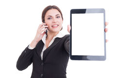 Elegant sales woman showing tablet with blank display Royalty Free Stock Image