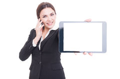 Elegant sales woman showing tablet with blank touchscreen Stock Image