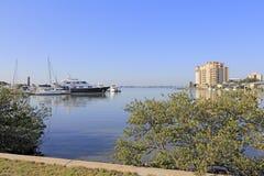 Elegant Sarasota Bay. SIESTA KEY, FLORIDA - MAY 9, 2013: Beautiful view from Sarasota overlooking Sarasota bay and the gulf coast waters, docked boats, buildings stock images