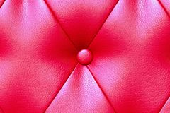 Elegant saturated glossy red leather texture of sofa chair stock images