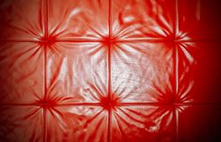 Elegant saturated glossy red leather texture of sofa chair stock photos
