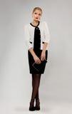 Elegant schoolgirl with notebook standing Royalty Free Stock Image