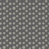 Elegant seamless pattern of many gold and purple snowflakes on d Stock Photography