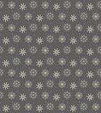 Elegant seamless pattern of many gold and purple snowflakes on d. Ark grey background. Christmas winter theme for gift wrapping. New Year seamless background for Royalty Free Stock Photos