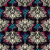 Elegant seamless pattern with royal lilies. Flowers on a black background. Royalty Free Stock Images
